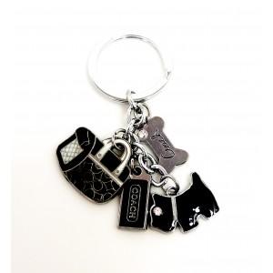 Bijou de sac ou porte-clés avec breloques en métal laqué noir