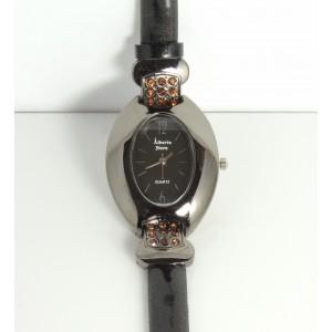 Montre ovale couleur ambre, bracelet fin en cuir verni