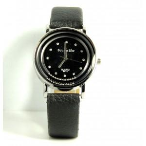 Montre ronde en métal argenté avec billes en acier, bracelet en cuir noir