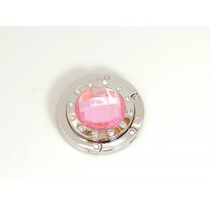 Porte sac en métal orné d'une pierre facettée en résine rose et strasss