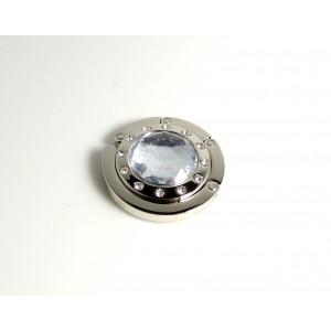 Porte sac en métal argenté orné d'une pierre facettée en résine gris clair et strass
