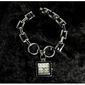 Montre bijou en métal argenté et cristaux blancs, IK Collection