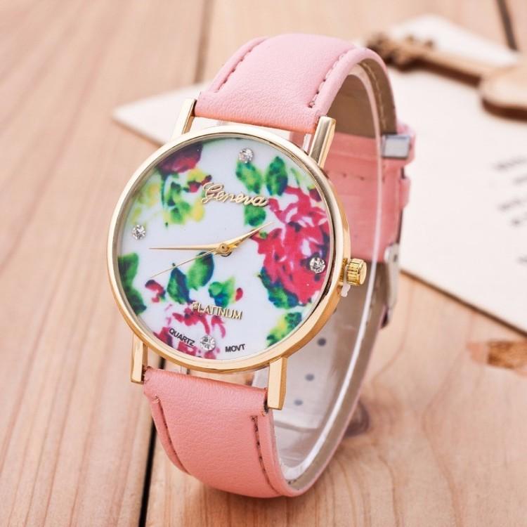 Montre ronde bracelet en cuir rose clair et cadran avec un d cor de fleurs stylis es maison for Montre decoration