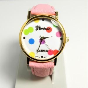 Montre avec cadran orné de confettis de couleurs différentes, bracelet rose clair
