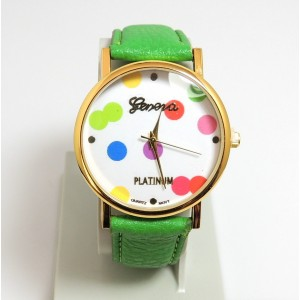 Montre avec cadran blanc orné de confettis de couleurs différentes, bracelet vert