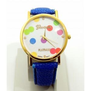 Montre avec cadran orné de confettis de couleurs différentes, bracelet bleu