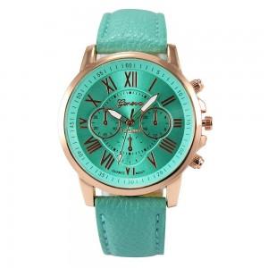 Montre avec un bracelet en cuir vert d'eau assorti au cadran, cadran et chiffres couleur or rose