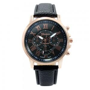 Montre avec un bracelet en cuir noir assorti au cadran, cadran et chiffres couleur or rose