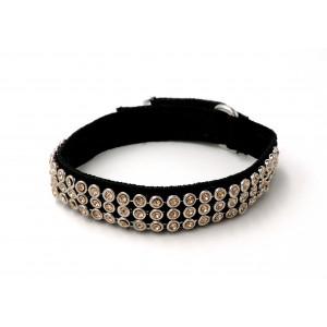 Bracelet en tissu élastique noir orné de strass jaune pâle sertis de métal