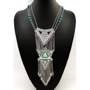 Collier de style ethnique avec grand pendentif en métal argenté, pierres et perles bleues