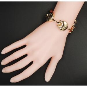 Bracelet design en métal doré de qualité, disques reliés par des tiges articulées