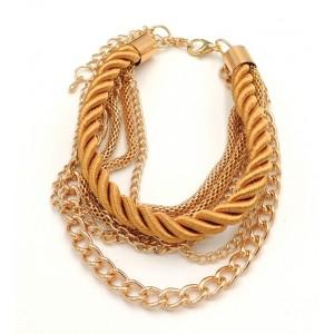 Bracelet multi-rangs en métal doré et cordon se soie or