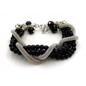 Bracelet avec des perles noires et chaîne tube en métal argenté