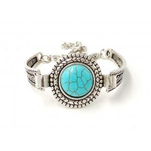 Bracelet tibétain en métal travaillé orné d'une pierre turquoise
