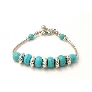 Bracelet tibétain en métal argenté, pierres turquoises et disque en métal travaillé