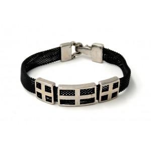 Bracelet avec des mailles en métal noir orné de 3 pièces en métal ajouré