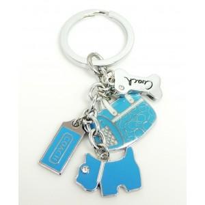 Bijou de sac ou porte-clés avec des breloques en métal laqué bleu