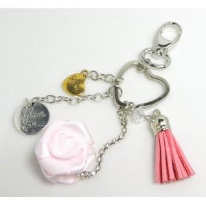Bijou de sac ou porte-clés en métal et cuir rose, fleur en soie