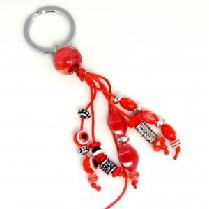 Porte-clés d'inspiration grecque avec pierres et perles rouge, motifs en métal