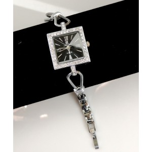 Montre bijou en métal argenté, boîtier orné de strass, IK Collection