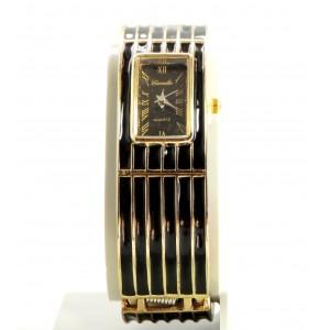 Montre bracelet rigide en métal doré et laque noire