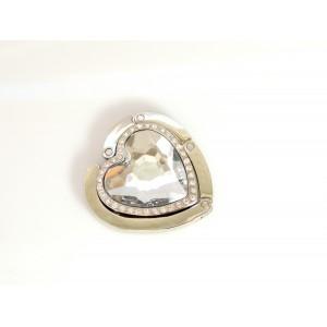 Porte sac en métal argenté articulé orné d'une pierre en résine blanche facettée en forme de coeur