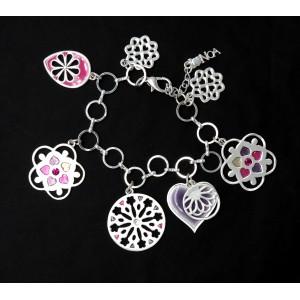Bracelet en métal argenté et breloques marque Pure by NOA