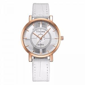 Montre originale avec un cadran blanc en partie évidé, bracelet blanc