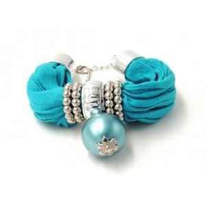 Bracelet en tissu de couleur turquoise ornés d'anneaux argentés