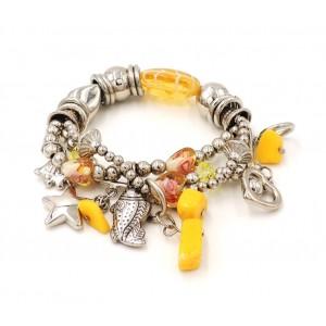 Bracelet en métal argenté orné de pierres jaunes et breloques en métal