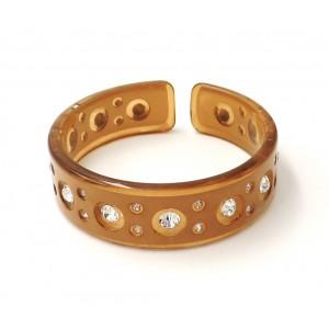 Bracelet en résine marron transparente ornée de strass blancs