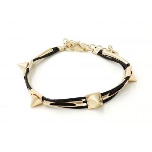Bracelet avec cordons cirés noirs, clous et tube métal doré