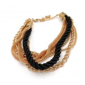 Bracelet multi-rangs en métal doré et cordon de soie noire