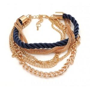 Bracelet emulti-rangs en métal doré et cordon de soie bleu marine