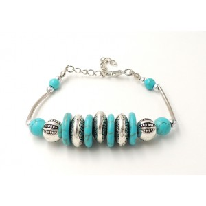Bracelet tibétain en métal argenté et pierres turquoises