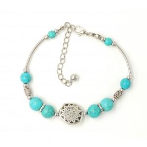 Bracelet tibétain avec des perles de pierre turquoise et métal argenté